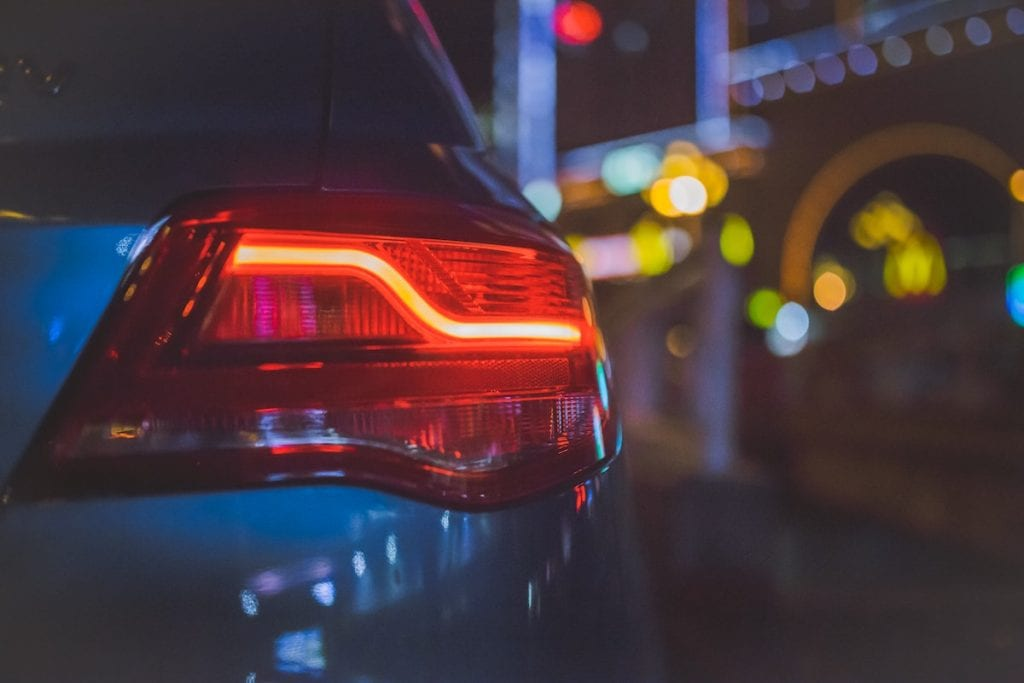 Car Tail Light on City Street