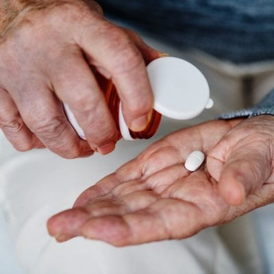 Elderly Patient Taking Medication
